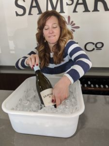 sarah adding wine to the ice bath