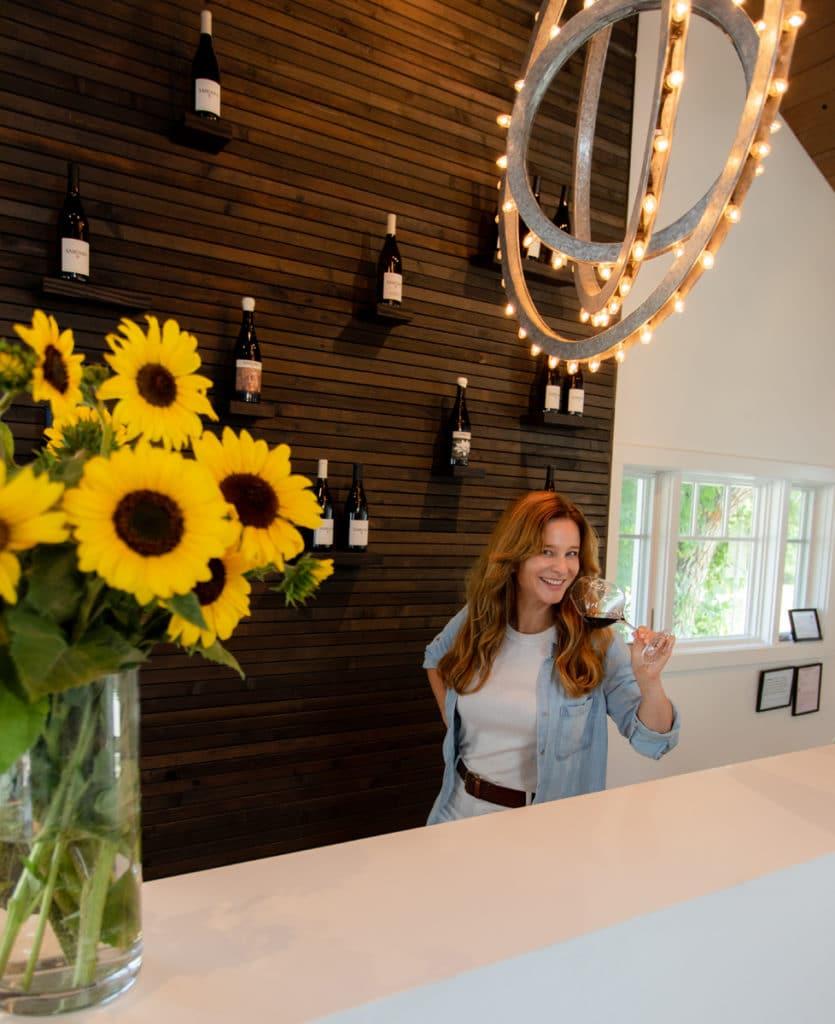 Sarah Newell, SAMsARA Marketing Director, is ready to welcome guests at SAMsARA's Los Olivos tasting room.