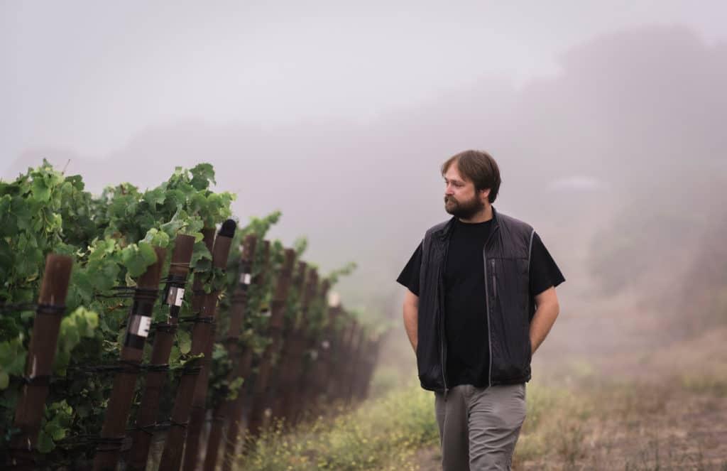 Matt Brady walks through the Rancho la Vina vineyards.